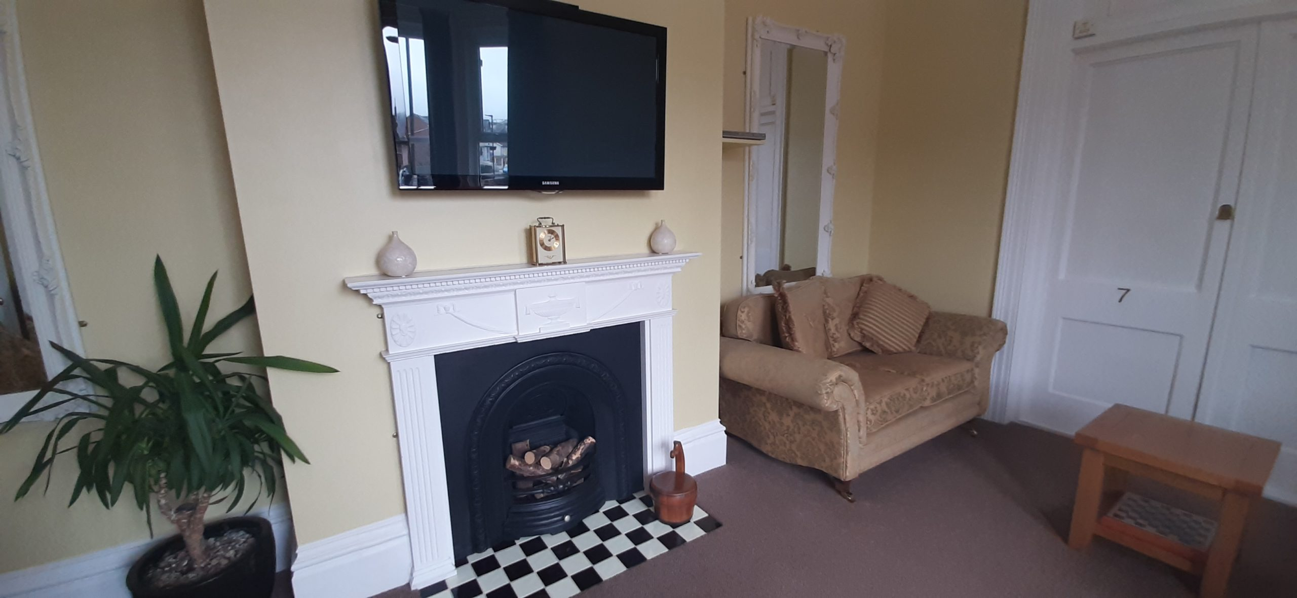 Showing the TV, Fireplace & Sofas in the Guest Lounge